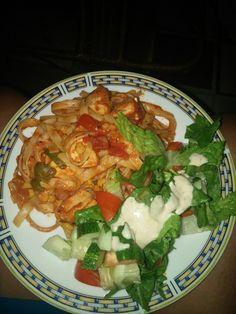 Chicken linguine in tomato sauce.