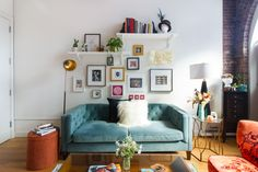 This bright blue couch and gallery wall combo has us screaming YES