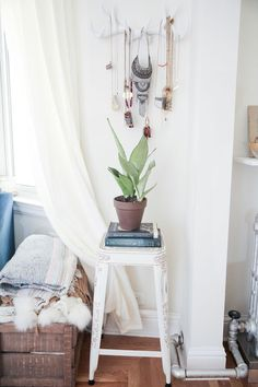 bedroom before and after, bedroom makeover, boho bedroom, bohemian bedroom, light and bright home decor, apartment decor, jewelry organization, white antlers, boho home design, wall hanging for jewelry, indoor plant