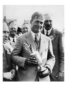 Bobby Jones poses with the Claret Jug at the awards ceremony after capturing the 1927 British Open at the Old Course in St. Andrews, Scotland. It was Jones's second consecutive Open Championship title. This vintage golf photo, taken by P Photo, appears courtesy of the Golf Digest Resource Center.
