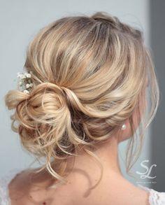 Curly textured bun by Stella Loewnich