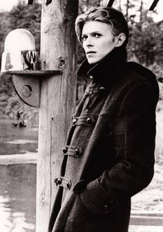 "on the set of ""The Man Who Fell to Earth"". David Bowie: one of my style icons. He's not just a man that makes music, he's a lifestyle choice. Angela Bowie, Duncan Jones, Stoner Rock, The Thin White Duke, Black White, Major Tom, New Wave, We Will Rock You, Ziggy Stardust"