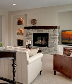 fireplace - i like the bottom of this fireplace. simple, modern.  want actual stone wall to be 10' tall. with dark mantle, similar to this one
