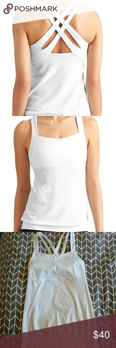 🆕 LISTING White Athleta Crisscross Back Tank Super cute white Athleta Crisscross back tank with breathable mesh. Built-in low impact bra, semi-fitted. Has a small snag under bra on right side (see 2nd to last photo). Slight discoloration of inner lining due to my washing machine 😕 Worn only a few times, great condition! Athleta Other
