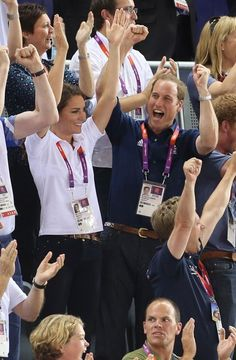 Catherine Duchess of Cambridge and Prince William doing the Mexican wave as they cheer on Great Britain and 5th time gold medalist Chris Hoy, along with Jason Kenny and Philip Hindes won the men's team sprint at the Velodrome in the Olympic Park during the London Olympic Games 2012 in London, August 2, 2012.
