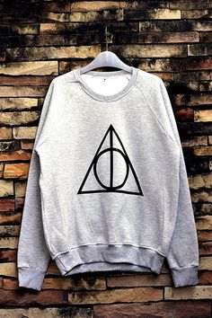 Hey, I found this really awesome Etsy listing at http://www.etsy.com/listing/169221414/deathly-hallows-harry-potter-sweatshirt