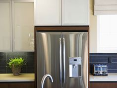 Removable adhesive sheets of Faux Steel Film (FauxSteel.com) instantly make over your refrigerator or dishwasher with a satin or nickel finish.