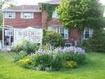 beautiful backyard at Lake Geneva Garden Home & Country Cottage - Vacation Rental Home in Lake Geneva, Wisconsin