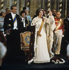 Crown Princess Beatrix of the Netherlands is crowned Queen following the abdication of Queen Juliana on 30 April 1980. Prince Claus (1926-2002) is at her side