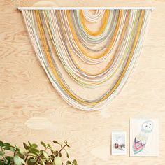 Create this beautiful yarn tapestry with yarn and a couple of simple and affordable supplies.