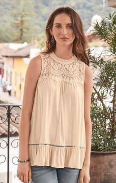 You'll adore the free-spirited romance of this mixed-lace, pleated tank.