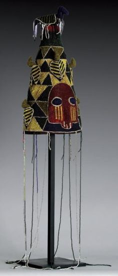 Africa   Beaded crown from the Yoruba people of Nigeria   Basketry, fabric and glass beads   This crown 'adenla ade' with its beaded veil is supposed to protect the wearer.
