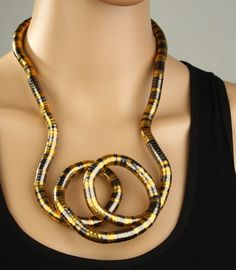bendable necklaces | See the small card with the code on it? The seller printed that out ...
