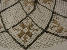 Fragment of a hairnet. The Elisabeth Church in Marburg. Silk, knotted mesh, embroidery, weaving