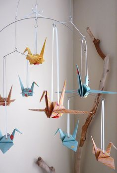Deck out your little one's nursery with this paper crane mobile.