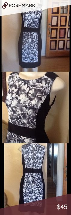 "MK Dress Beautiful black and white shift dress.  Flower print panel that runs down the front.  Exposed zipper in back.  Lined.  In excellent condition.  Size 6 measures 18"" bust, 16"" waist, 20"" hips. 37"" length.  Material 80% cotton, 18% nylon, 2% spandex.  Bundle and save.  No holds and no trades.  Please use offer to negotiate. MICHAEL Michael Kors Dresses"