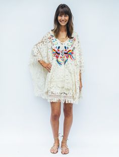 Our Otomi Embroidery Poncho Dress will take you from the pool to dinner in style. Featuring a boho chic embroidered bird pattern.