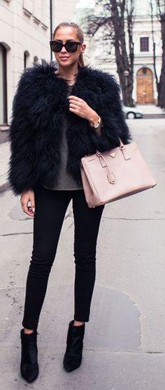 Kenza Zouiten is wearing a Pello Bello fur jacket, Jennie-Ellen boots and a Prada handbag