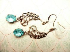 Antiqued Brass filigree feather and aqua crystal by VerdegrisGifts, $25.00