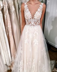 This Bateau Neckline Wedding Dress is covered in beautiful floral lace designs from neck to toe. The top of the dress features an unlined bodice, putting the lace on full display, while the bottom of the dress features more flowing lace and tulle. style:  #J6578 ⠀⠀⠀⠀⠀⠀⠀⠀⠀  #Moonlightbridal #weddingdress #weddingdresses #bridalfashion #weddingbells