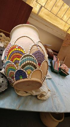 Fish scale mosaic design on a shapely flower pot. Photo by Yehudit Barak.Go to gym dandy and find plates and bowls and cups to break and create withMosaic vase work in progressLike this design, could try in colors also - Salvabrani