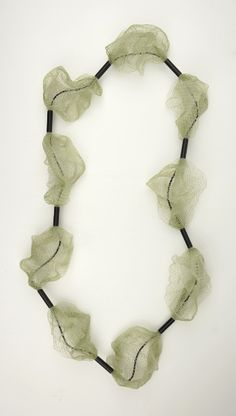 Catrine Berlatier : nylon netting, plastic tubing, rubber cord