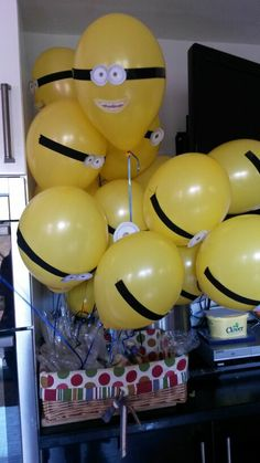 Minion Balloons tied to sweet filled party bags
