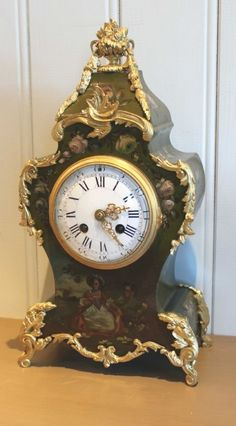 FRENCH PAINTED AND ORMOLU MOUNTED MANTEL CLOCK