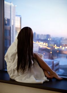 Watching the nighttime cityscape after an evening bath....