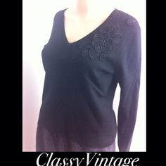 Black silk blend knit top. Black silk , viscose  and nylon blend knit top. This is a large petite. V neck and embellished top left with flower and beads. g Tops