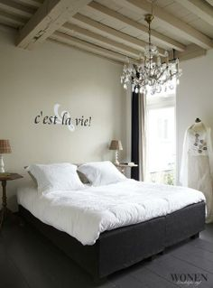 "Romantic setting. Wall with text ""C'est la vie"". #RTLWoonmagazine"