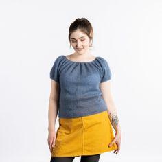 Cecilie är en mjuk och lätt tröja stickad i Kid Silk. Tröjan är en bred, lös modell med korta ärmar. Det gör den otroligt behaglig att bära. Cecilie kan användas både till vardag och till fest - så du kan precis lika bra sätta igång med den nya tröjan på en gång. Den kommer säkert att användas flitigt ;) Stickfasthet 25 maskor och 33 varv = 10 cm i slätstickning på 3,5 mm sticka. #hobbiidesign #hobbiicecilie #hobbiikidsilk Casual Shorts, Denim, Knitting, Fashion, Mittens, Yarns, Caps Hats, Crocheting, Amigurumi