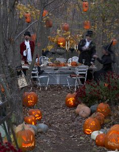 Illuminated jack-o'-lanterns line the walkway to this dinner table decorated with vintage Halloween decor.