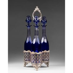 Magnificent French Decanter Tantalus, With Silver Plated Tripartite Rack Holding Three Matching Baccarat Cut To Clear Cobalt Decanters, Pattern Harcourt, The Slender Bottles Fit Snugly Into The Filigreed Compartments Supported On Scrolled Legs With Center Handle c.19th Century