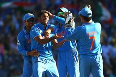 Umesh Yadav of India celebrates with his team after taking the wicket of Aaron Finch of Australia during the 2015 Cricket World Cup Semi Final match between Australia and India at Sydney Cricket Ground on March 26, 2015 in Sydney, Australia.