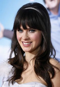 Zooey Deschanel. Flawless. Every time i see her I want to color my hair black. Maybe this fall/winter.