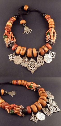Morocco | Berber necklace; old amber, natural branch coral, shells, glass beads, silver amulets / pendants |