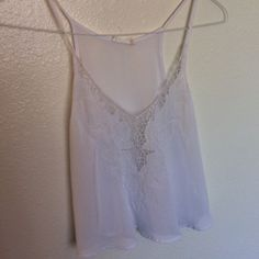Beautiful cropped floral tank Sheer white tank top with v neck and floral embroidered detail. Similar to the Brandy one but this one is by lush Brandy Melville Tops Tank Tops