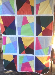 My second stack and slash quilt love the opposite colour tones bordered in white