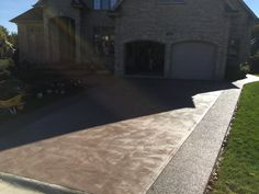Swirl Finished Concrete Driveway with Exposed Aggregate Borders in London Ontario Exposed Aggregate, Driveway Ideas, Concrete Driveways, Ontario, Sidewalk, It Is Finished, London, Decor, Garage Ideas