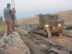 PHOTO #Apartheid #Israel destroying paved road in #WestBank'
