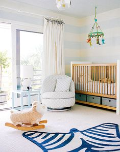 "Totally great idea to put a comfy chair next to the crib. Easy peasy for bedtime stories.  Note: Also love the simplified ""animal skin"" rug"