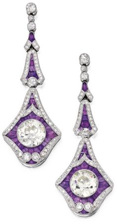 Pair of Platinum, Amethyst and Diamond Earrings Anchored by two round diamonds weighing 2.87 and 2.80 carats, the frames set with single and old European-cut diamonds weighing approximately 1.65 carats, further decorated with calibré-cut amethysts.
