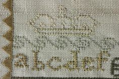 We are pleased to offer this antique embroidered sampler by Ann Wilkin dated 1799.  We believe the thread is silk and that it was embroidered on off-white linen