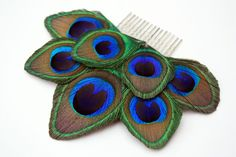 Daring - Peacock feather hair comb / Peacock feather fascinator. $30.00, via Etsy. Love this...would look so nice against my dark hair and the opposite side of the bun I plan to have.