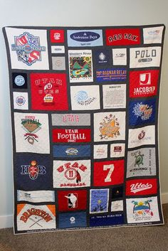 Best looking T-shirt quilt I've seen.  I like the black borders around everything. Save kids old t shirts as thy grow and then make it for them hen they move out of the house. Memories to sleep with in a college dorm.