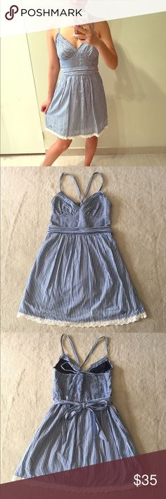 Gilly Hicks blue and white sundress Gilly Hicks blue and white sundress. Gently used in good condition. No trades. Small spot as pictured in last photo. Please ask all questions before purchasing and use the offer button, thanks! Gilly Hicks Dresses