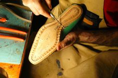 preparing the insole for hand welting using an awl and making each stitch hole individually