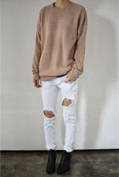 white ripped jeans and beige baggy jersey with ankle boots