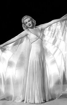 "fashion1930s: "" #1930sfashion Ginger Rogers in a fabulous silk gown and matching cape. """